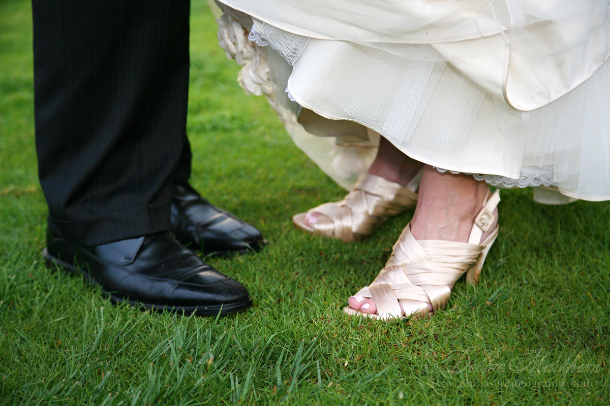 Beautiful Cloudy Day Wedding at Ragged Point-Bride and Groom's shoes outside-email size