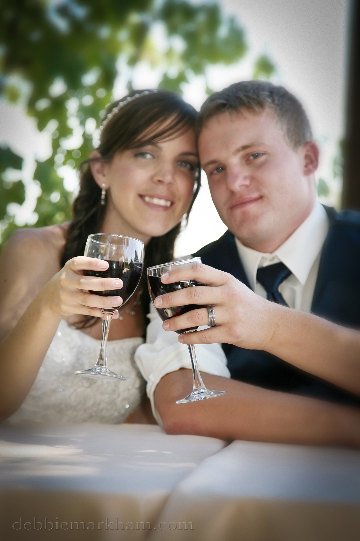Cambria Photographer Debbie Markham-Paso Robles Wine Country Wedding at Castoro Winery-Bride and Groom Toast with Wine