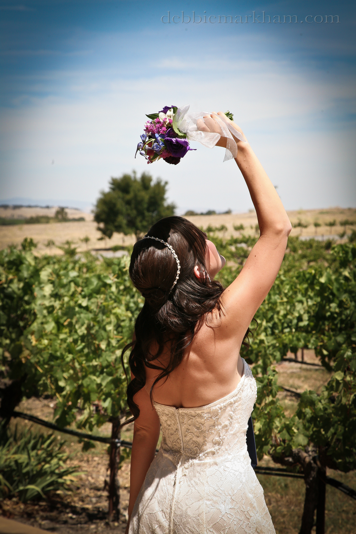 Cambria Photographer Debbie Markham-Paso Robles Wine Country Wedding at Castoro Winery-Bride tossing bouquet at vineyard