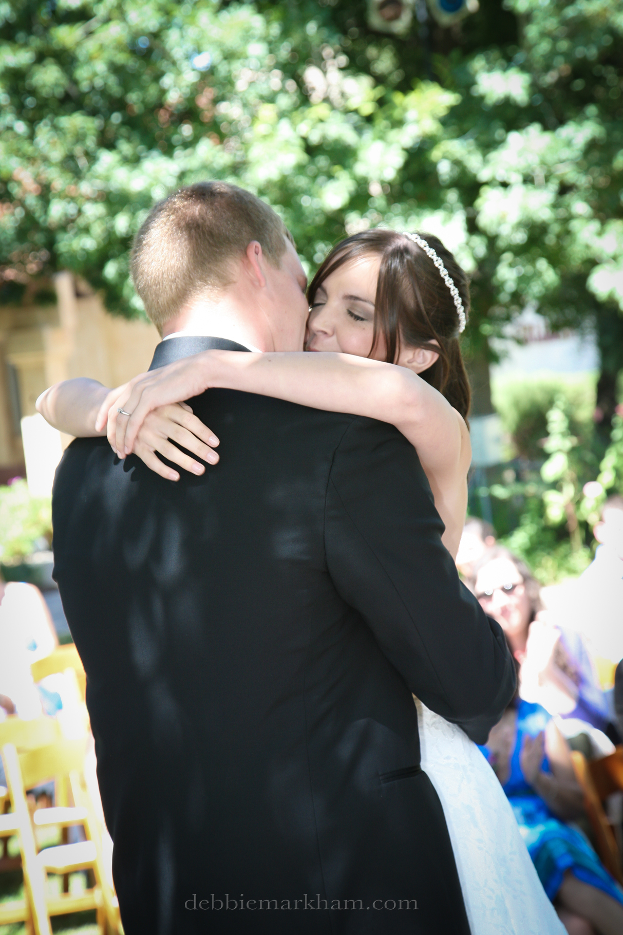 Cambria Photographer Debbie Markham-Professional Wedding Photos at Castoro Winery - Vineyards Outdoor-bride hugging groom