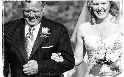 Happy Dad with Daughter walking down the Isle - Cambria Photographer Debbie Markham