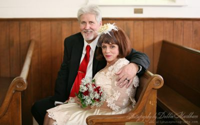 Santa Rosa Chapel Wedding photo in pew by Cambria Photographer Debbie Markham