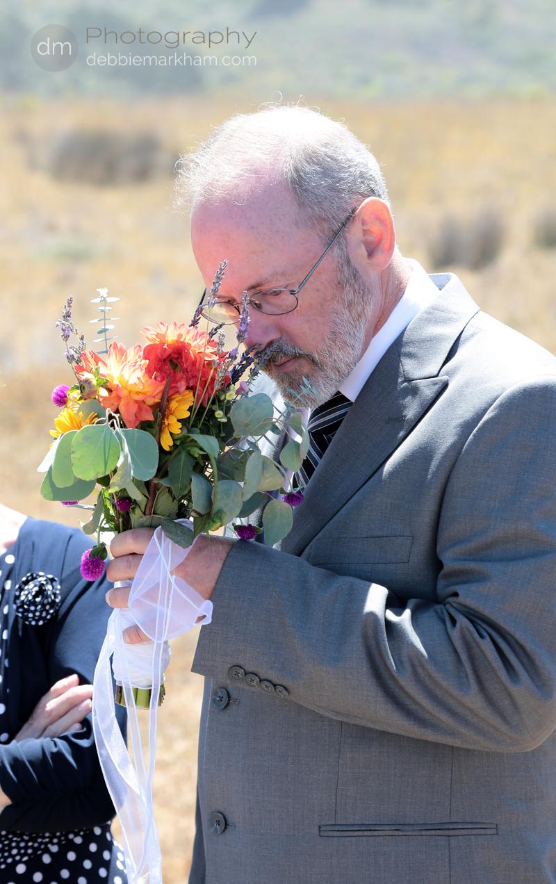 wm-dad treasures daughter's bouquet-photojournalistic-Debbie Markham Wedding Photography-Big Sur-Pacific Valley-Laurel-Brian-June21-2013-130