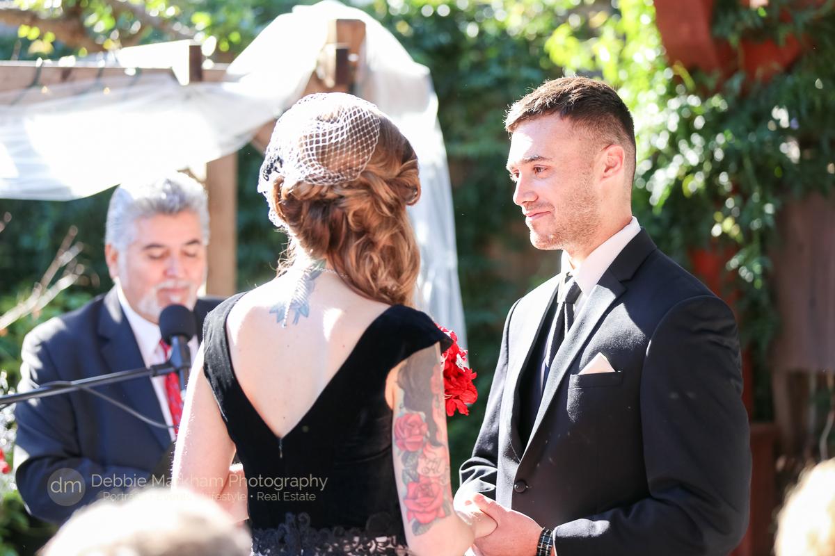 Wedding-Reception_Robin's_Cambria_Destination Wedding_California_Photographer_Debbie Markham_Black Dress_Red Flowers-4433